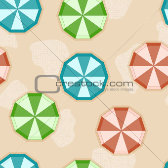 vector seamless background with sun umbrellas on sandy beach