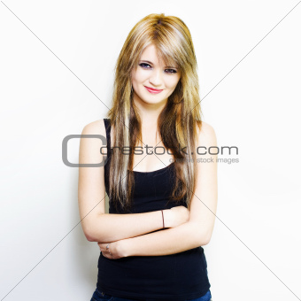 Pretty blonde standing with subtle smile