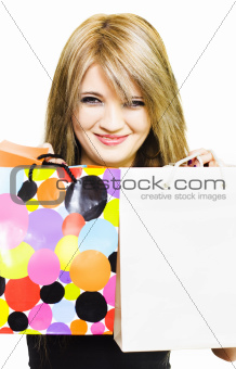 Happy smiling woman holding shopping bags