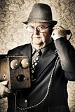 Vintage business man using retro telephone