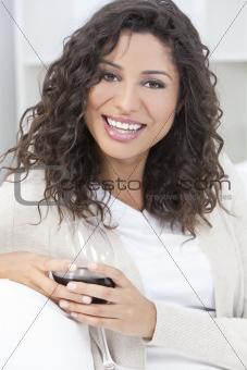 Happy Hispanic Latina Woman Drinking Red Wine