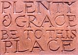 Writing on a terracotta wall plaque