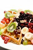 Waffle plate garnished with fresh fruit