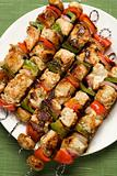 Barbequed kebabs on a plate