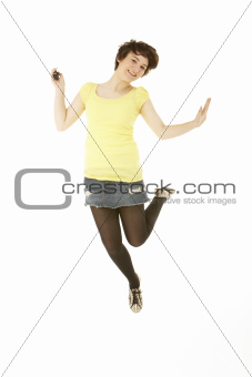 Studio Portrait Of Teenage Girl Jumping In Air
