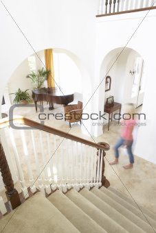 House Interior Showing Staircase And Abstract Female Figure