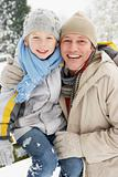 Father And Son Standing Outside In Snowy Landscape