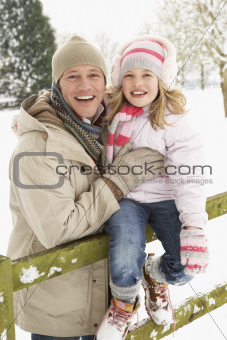 Father And Daughter Standing Outside In Snowy Landscape