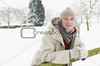 Man Standing Outside In Snowy Landscape