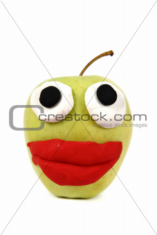 green apple with plasticine smile