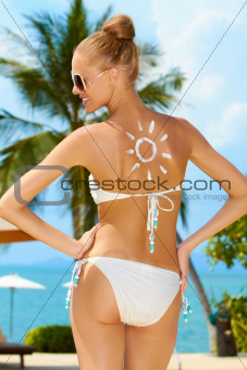 Woman with a sun painted on her back