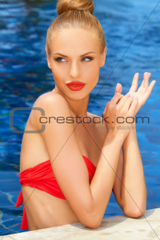 Gorgeous blonde lady in the pool