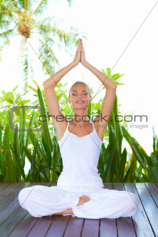 Woman doing yoga breathing exercises