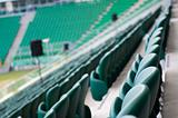 green empty seats at the stadium