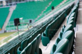 green empty seats at the stadium