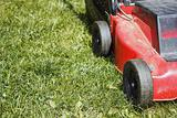 detail of lawnmower on green grass