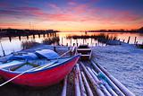 Beautiful sunset with boats at the coast