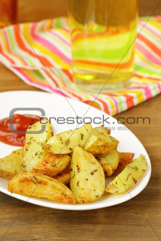 fresh  fried potatoes on a wooden table
