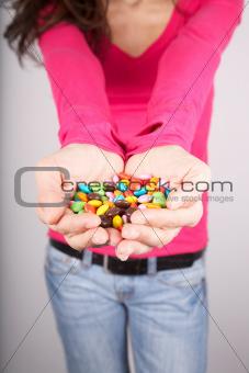 chocolate pills on palm
