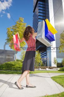 happy shopper woman down skyscrapers