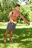 Full body of fitness man in park