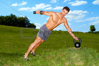 Fitness man practicing with weights