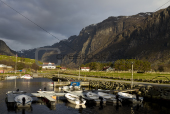 small harbor with mountains in background