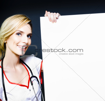 Smiling healthcare professional with a blank board
