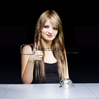 Business woman at desk with thumbs up on black