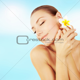 Woman enjoying day spa on the beach
