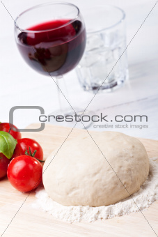 raw yeast dough on a chopping board
