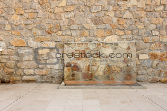 Water source in wall of stone
