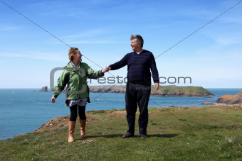 Mature couple on the coastal path