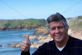 Mature man giving the thumbs up