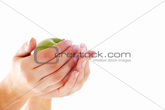Female hands with nice manicure and apple