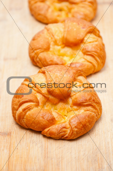 fresh baked french croissant brioche on wood board