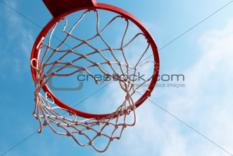 Basketball hoop on blue sky