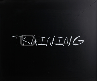 """Training"" handwritten with white chalk on a blackboard"
