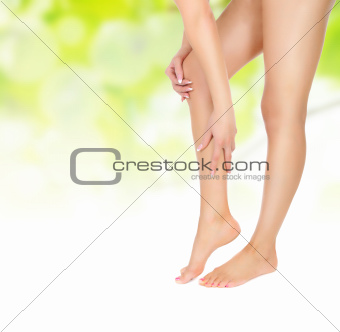 female legs being massaged with hands