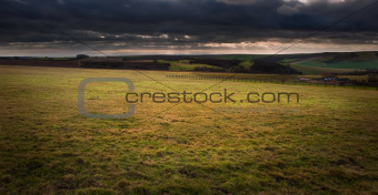 Dark moody cloud formations over English countryside landscape