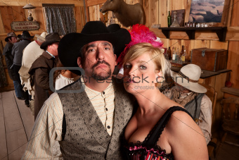 Tough Cowboy and Showgirl in Saloon