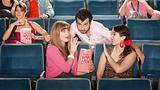 Men and Women Flirting in Theater