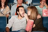 Woman Feeds Boyfriend at Movie