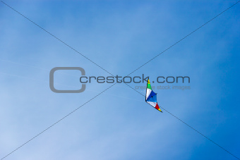 colorful kite soaring in a nice blue sky