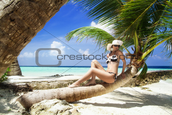 Beautiful shapely woman on tropical beach