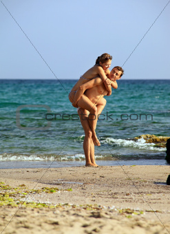 Young caucasian couple at the beach