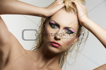 blonde girl's beauty portrait she looks in to the lens