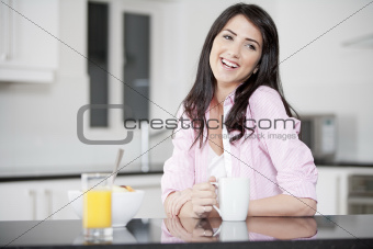 Young woman enjoying breakfast