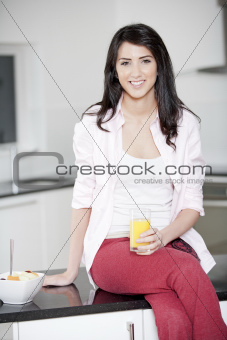 Young woman enjoying a glass of juice