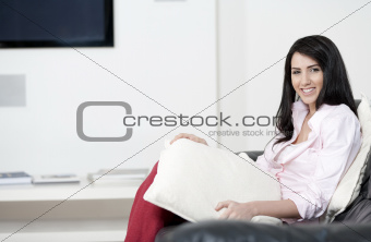 Young woman resting on sofa